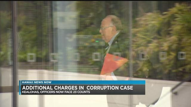 Ex-police chief, deputy prosecutor wife indicted on more federal charges
