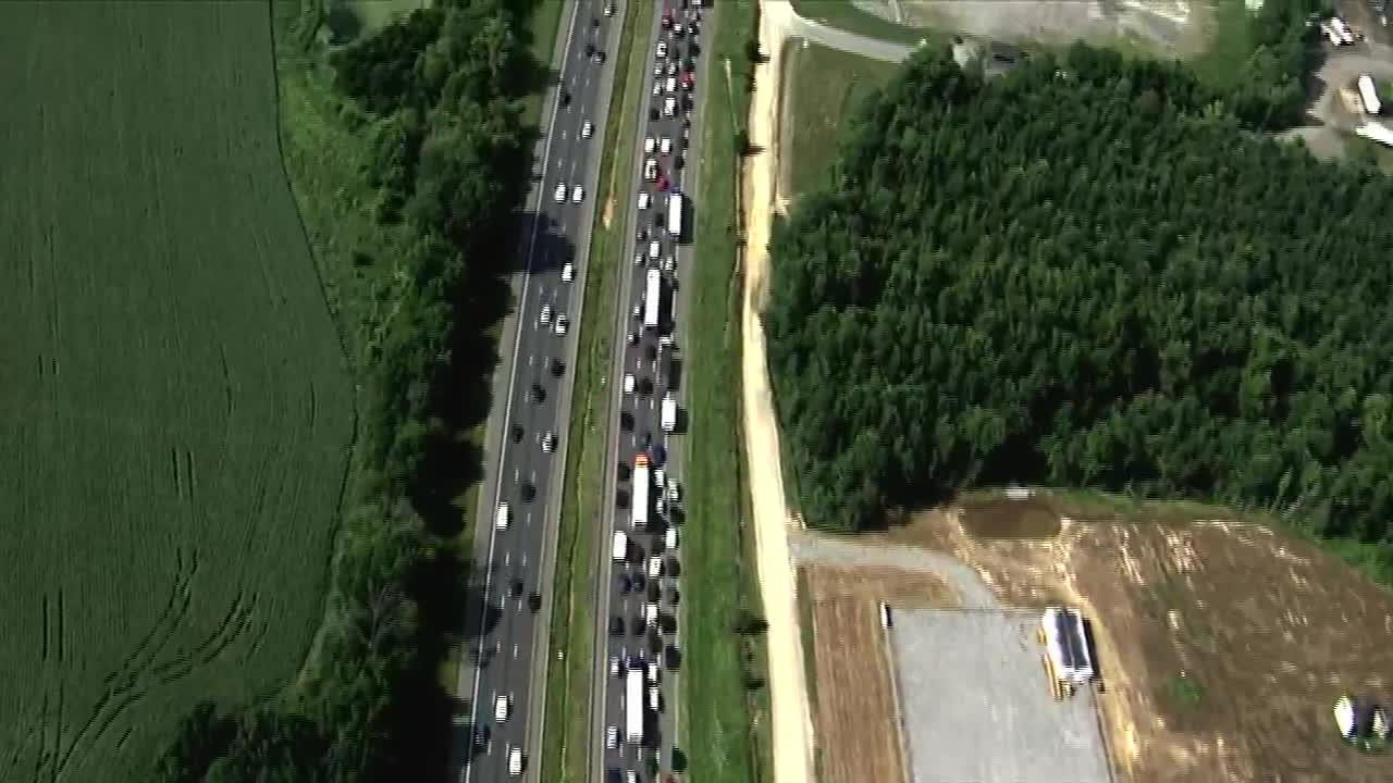 2 killed, others injured in crash that caused 11-mile backup