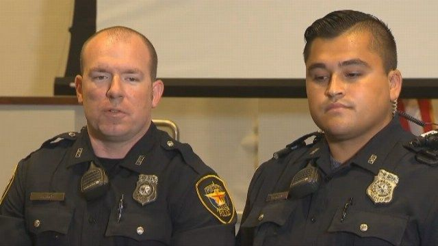 Image result for Special shout out to officers Justin Henry and partner Trae Cierzan who saved a woman who was attempting to jump off a highway over pass, about 80 feet above the ground.