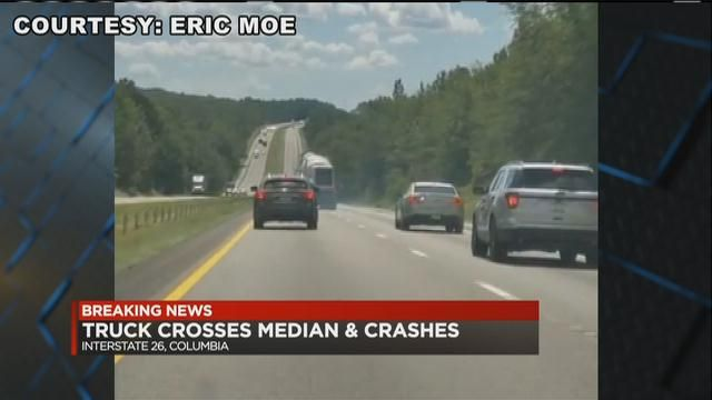 VIDEO: Concrete truck swerves in traffic, crosses median before